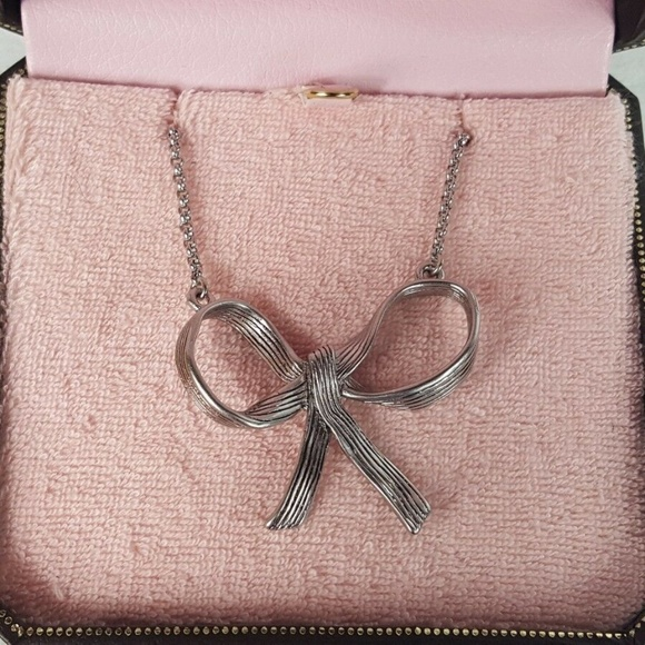 Juicy Couture Jewelry - Juicy Couture  Silver Tone Bow Pendant Necklace